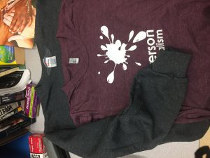 A Ryerson School of Journalism t-shirt and sweater.